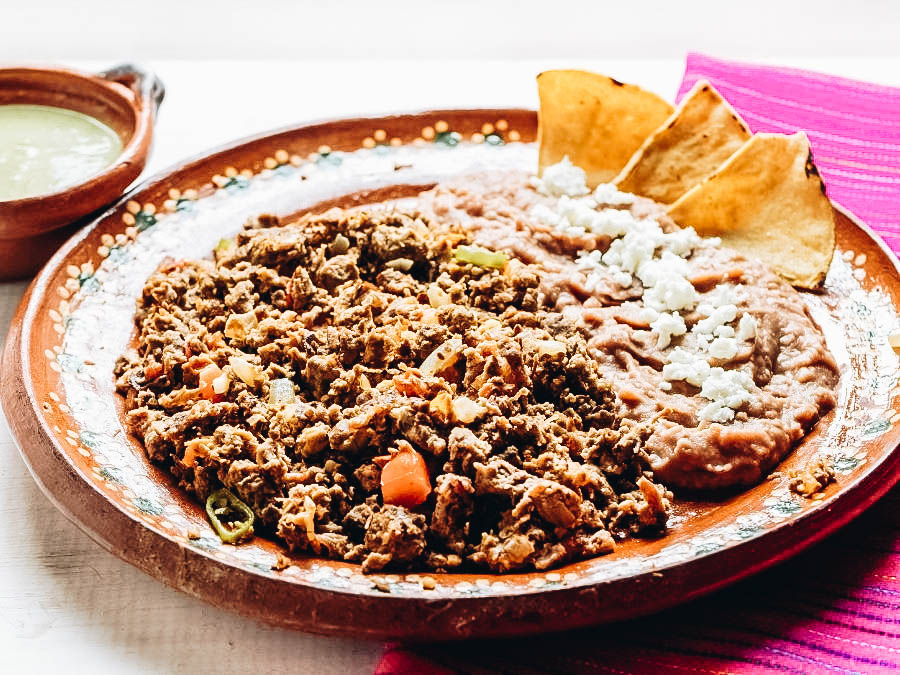 Machaca served with rice and chips