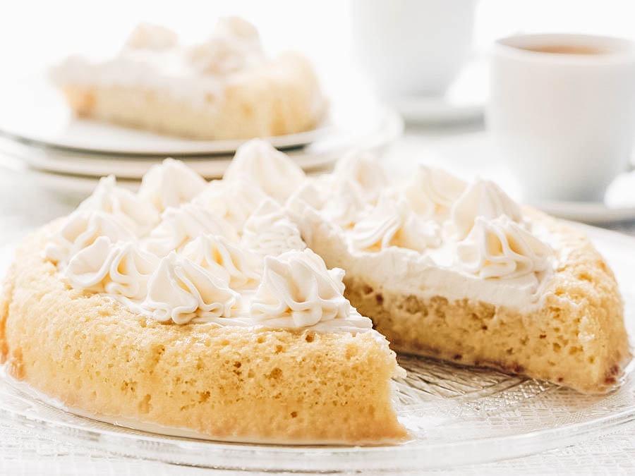Sweet Pan Tres Leches served with coffee