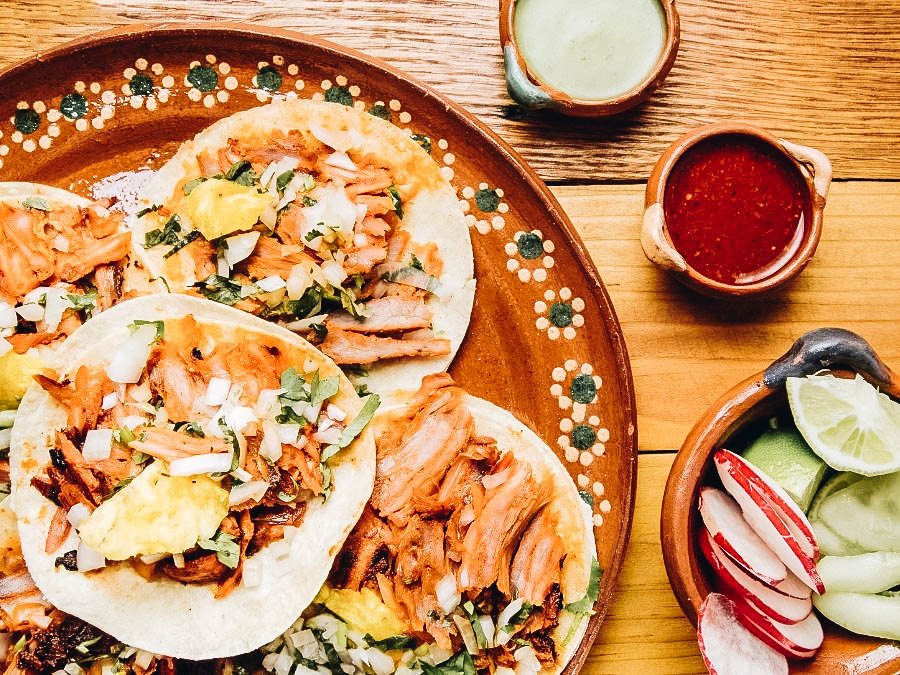 Tacos al pastor with sauce and veggies