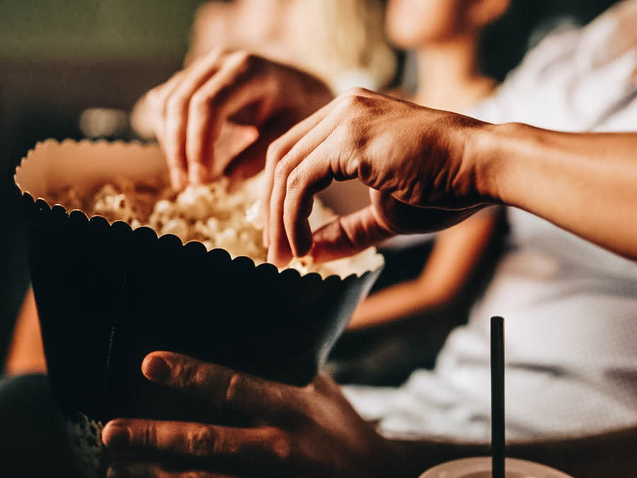 People eating popcorns while watching movie