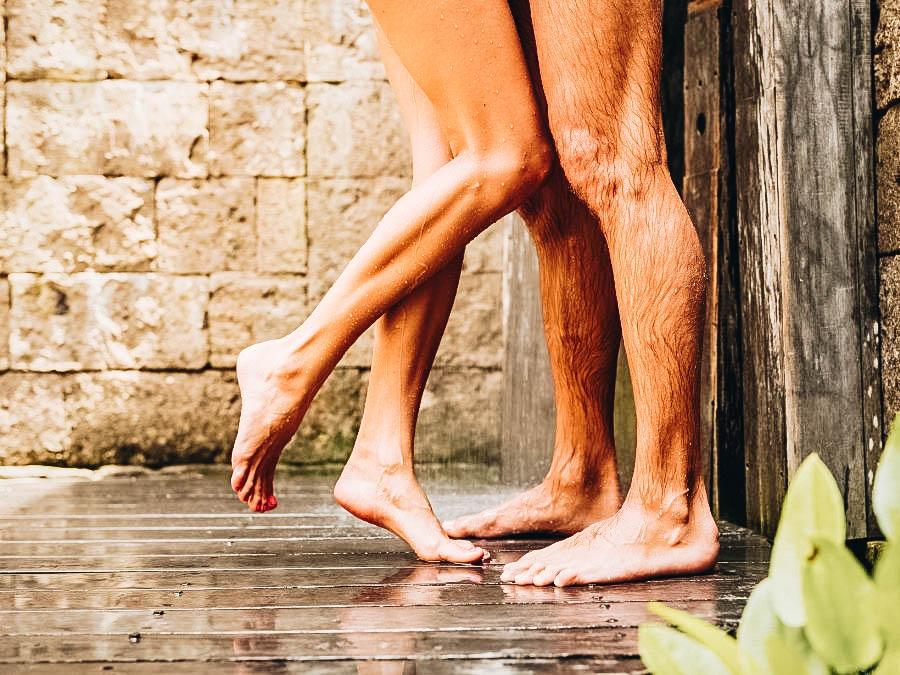 A couple taking a bath outside