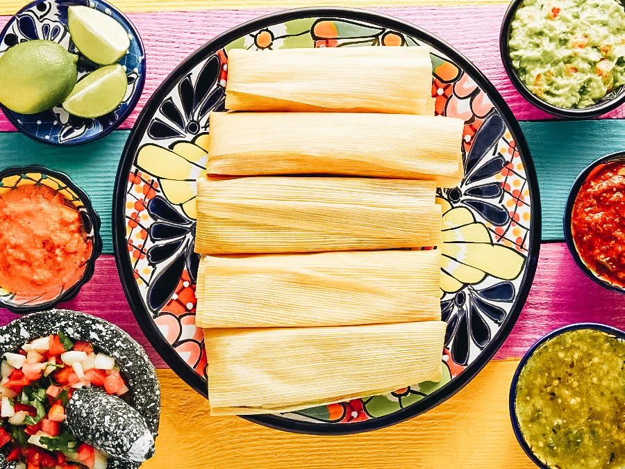 Tamales on a colorful plate