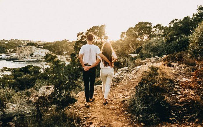 A couple walking walking on a path