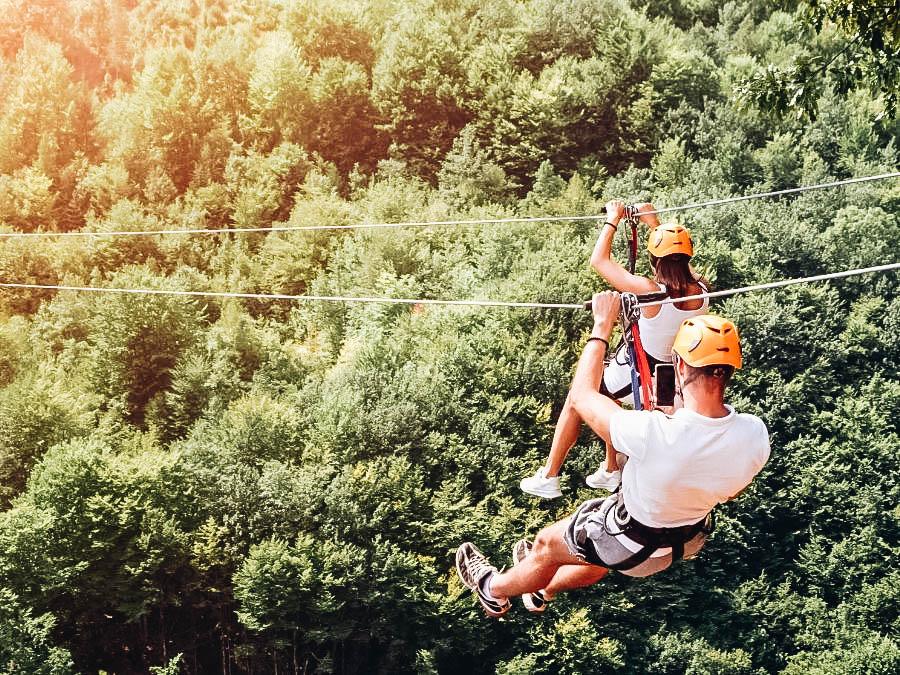A couple having a zip line adventure