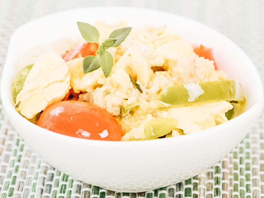 A Jamaican Ackee & Saltfish on a white bowl
