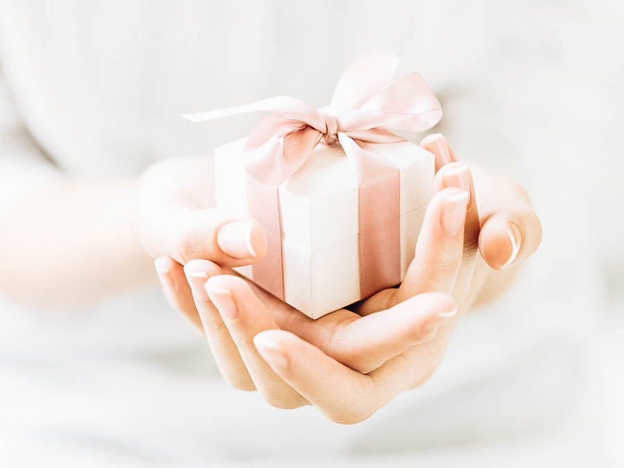 A person holding a gift