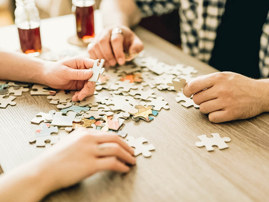 A couple completing a jigsaw puzzle