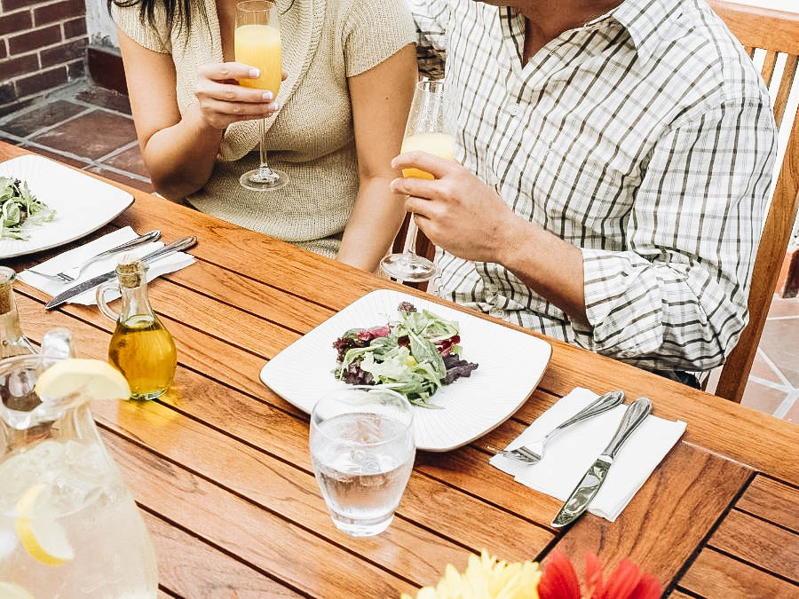 A couple having brunch and drinking mimosas