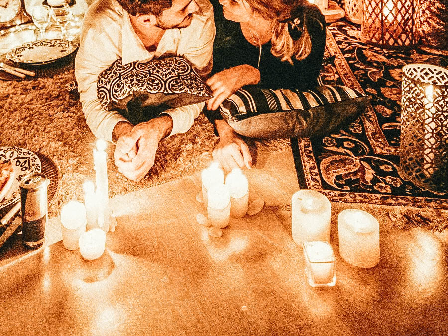 A couple having a candlelight dinner at home