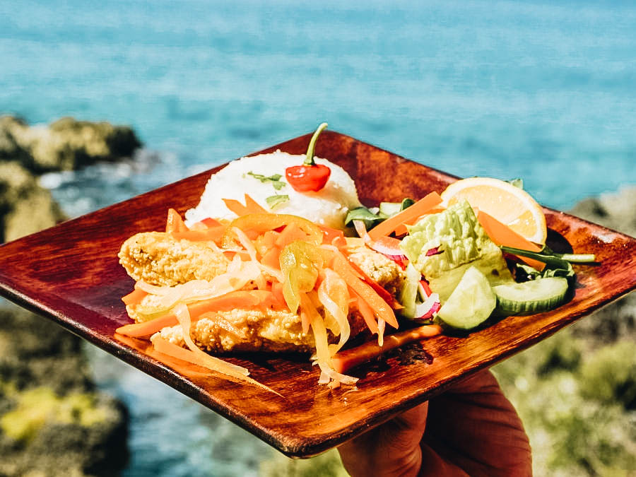 A sumptuous Escovitch Fish on a brown plate