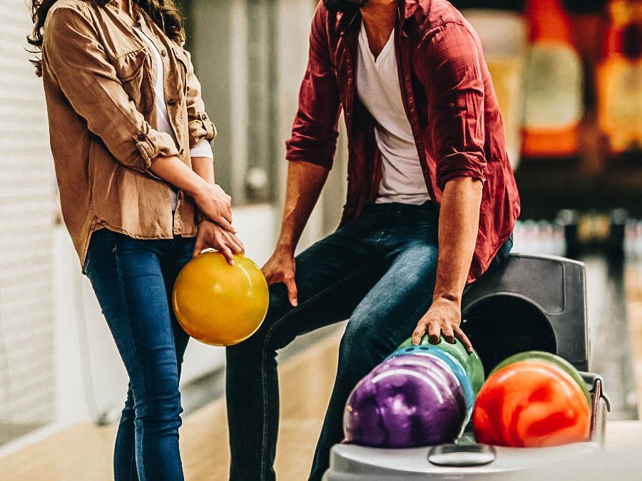 A couple preparing to start bowling
