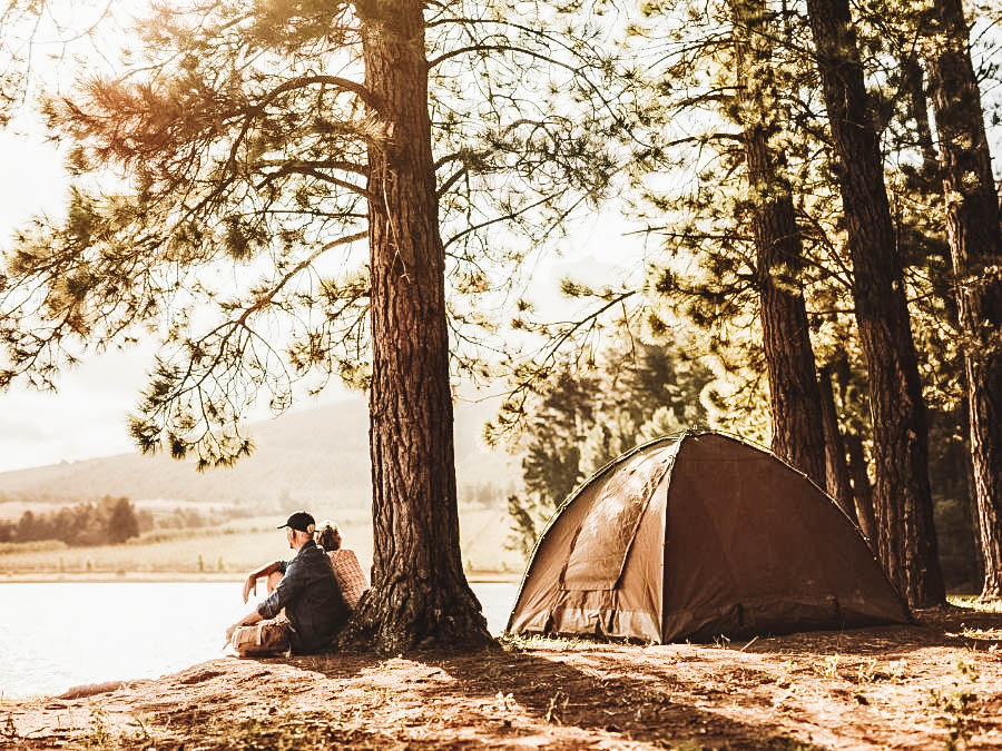 A couple having a camping date night