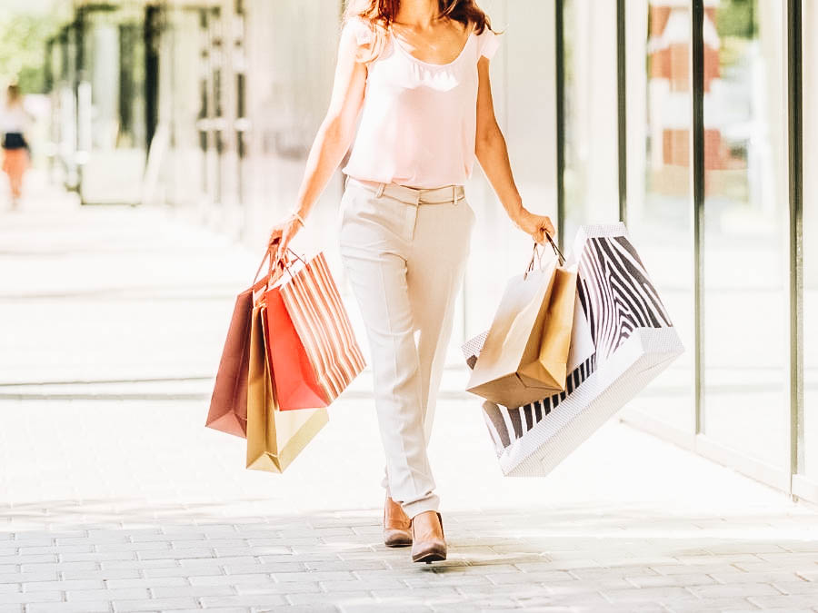 A woman walking with shopping bags