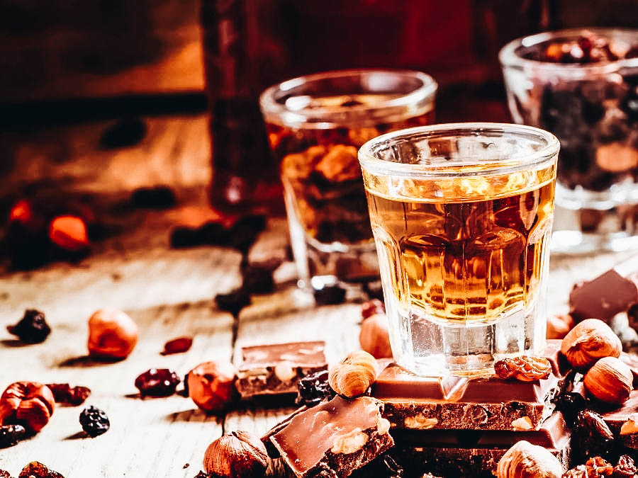 A Jamaican Rum on a table with chocolates