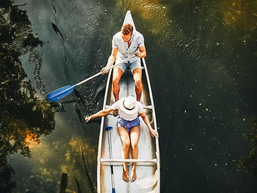 A couple paddling a canoe