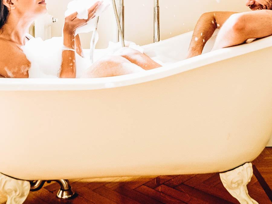 A couple taking a bath together