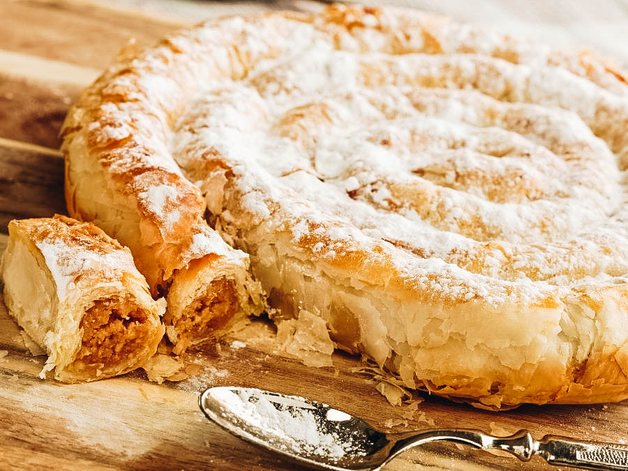 Almond Snake Pastry on a brown table