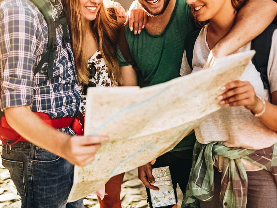 Friends looking at a map, travelling