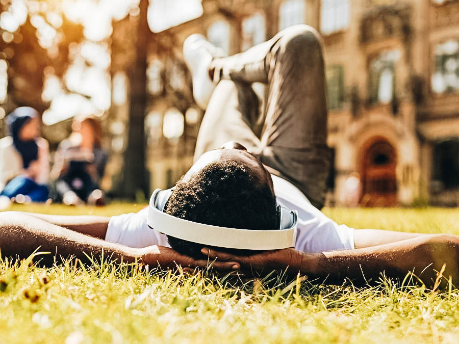A student laying on the campus ground