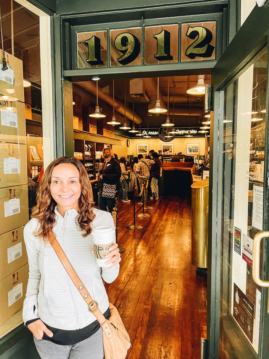 Annette White of Bucket List Journey at the Original Starbucks in Seattle Washington