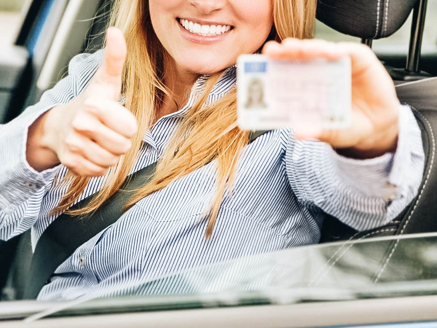 A woman showing her new license