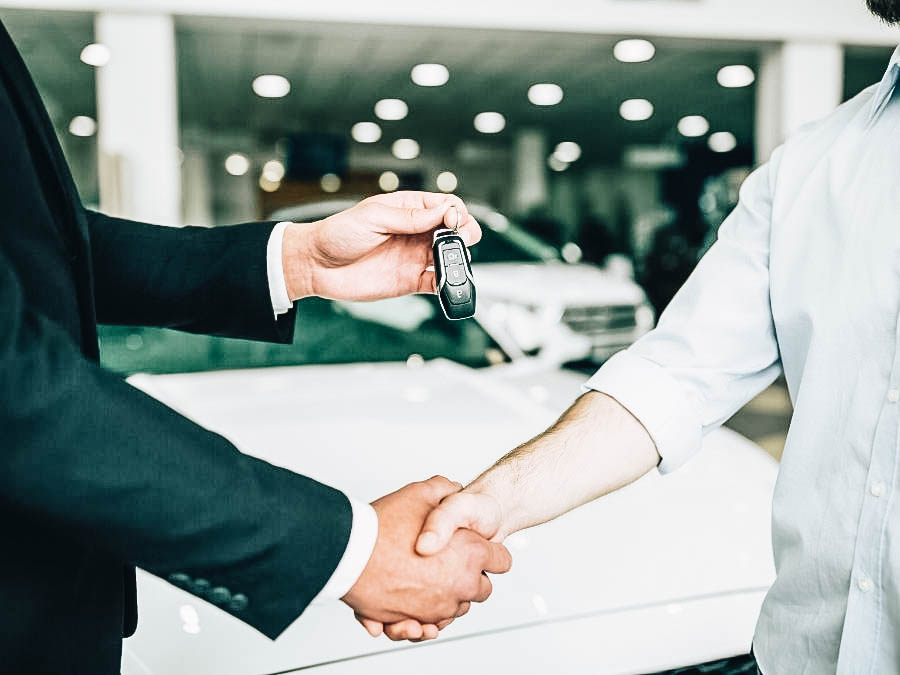 A young woman buying her first car