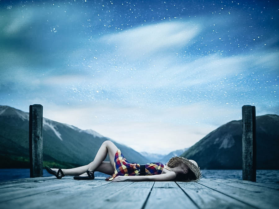 A young woman laying outside watching the stars