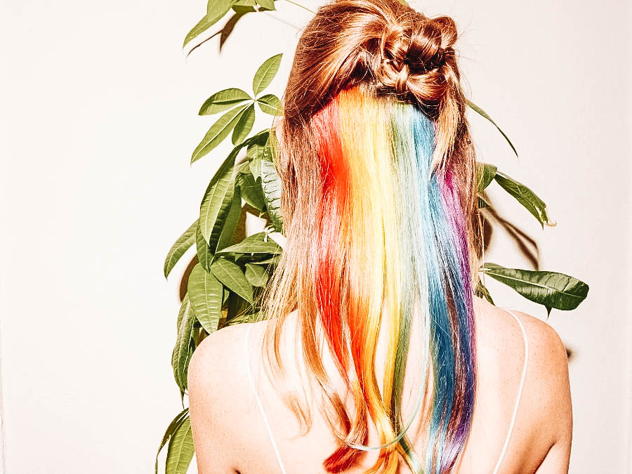 A teenager showing off her new haircolor