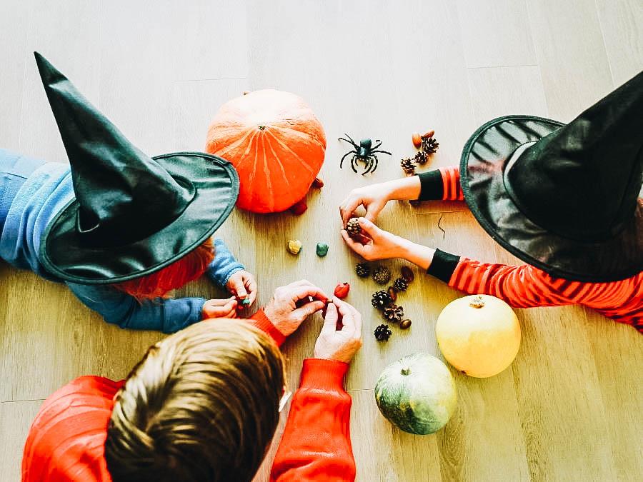 A guy teaching kids how to make Halloween designs