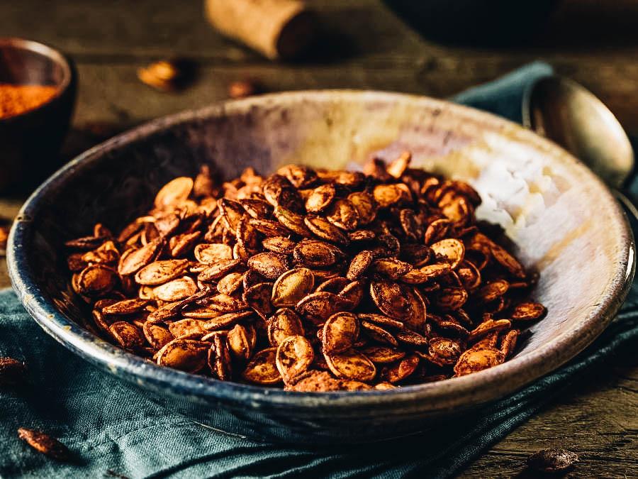 Roasted Pumpkin Seeds on a brown plate