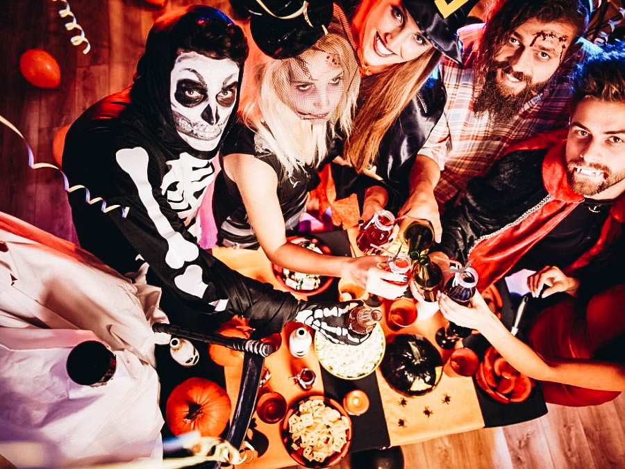 Group of people on costume in a Halloween party