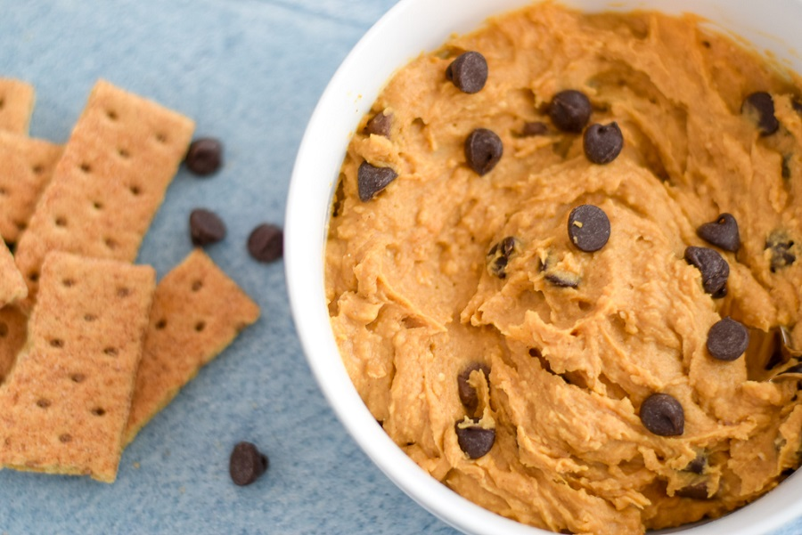 Sweet Potato Cookie Dough Dip is the perfect appetizer for your sweet tooth. Made with all real ingredients, this dip boasts extra flavor from the sweet potatoes, and goes perfectly with fruit, chocolate and graham crackers | Vegan, Gluten Free Snacks
