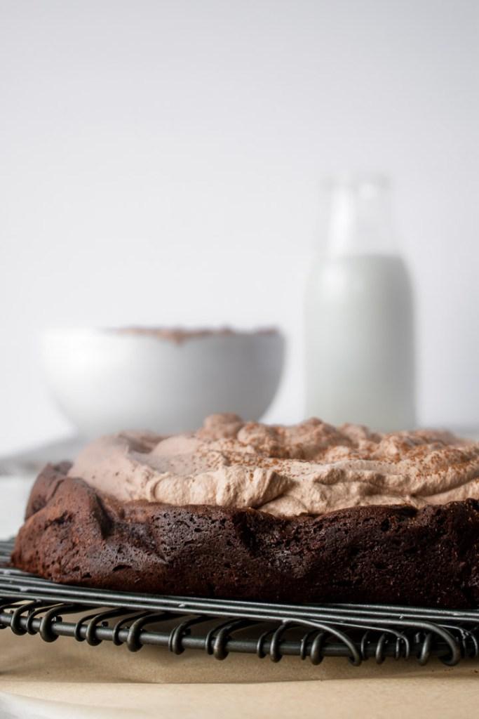 Espresso whipped cream on chocolate flourless cake