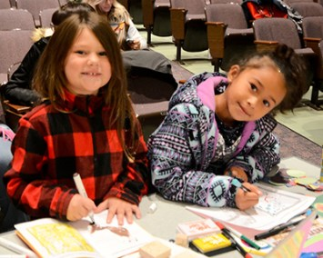Young artists creating a book