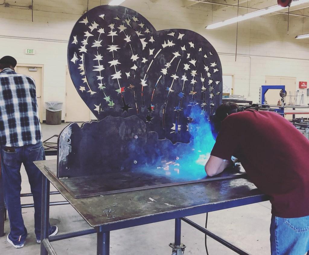 Zach Shamblin welding the base of Steel Cut Barrel Cactus