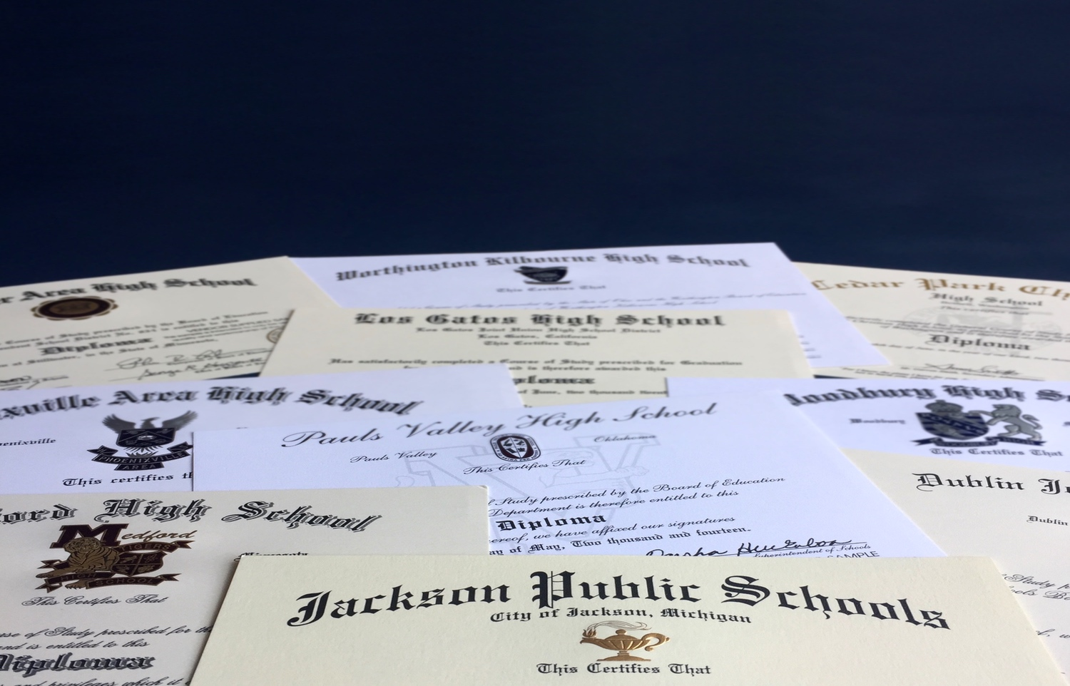 Photo of multiple diplomas scattered