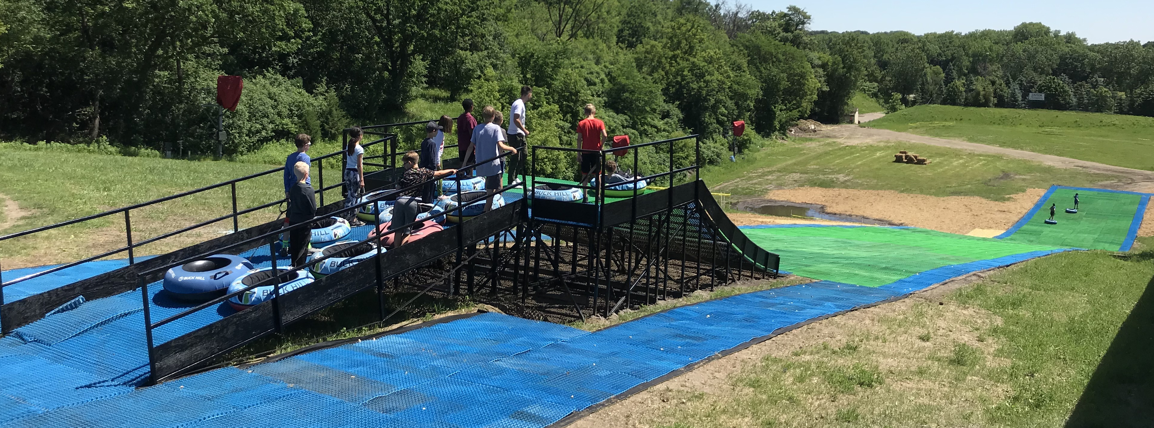 Top of tubing hill in summer time