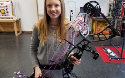 Alexis shooting her new Hoyt Powermax with the Vixen Package