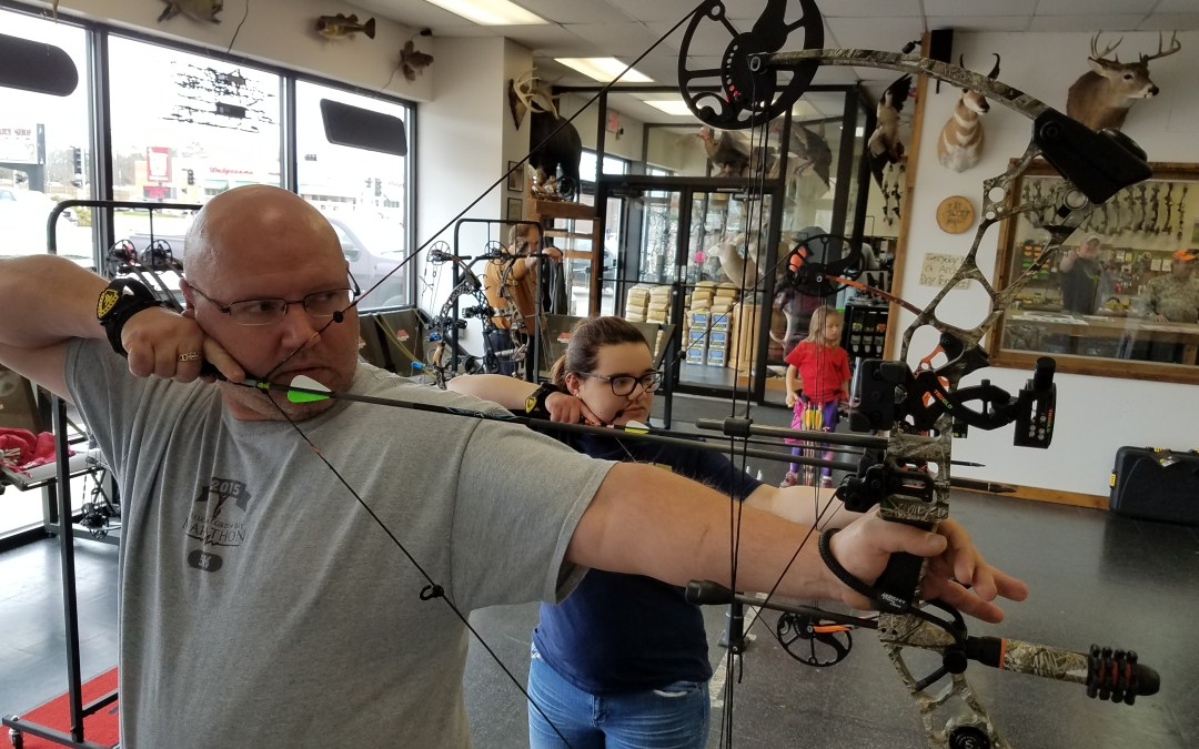 Bailey makes archery fun with her dad……