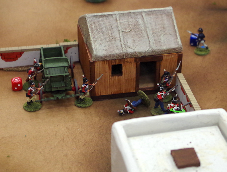 British defending the supplies, which were stored in the wooden building with canvas roof.