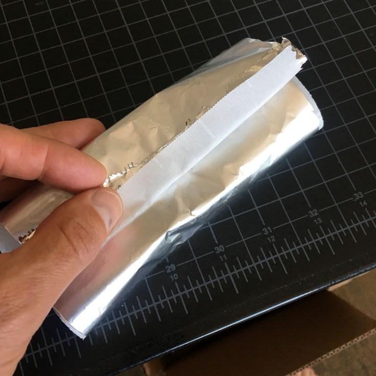 paper folded around bar