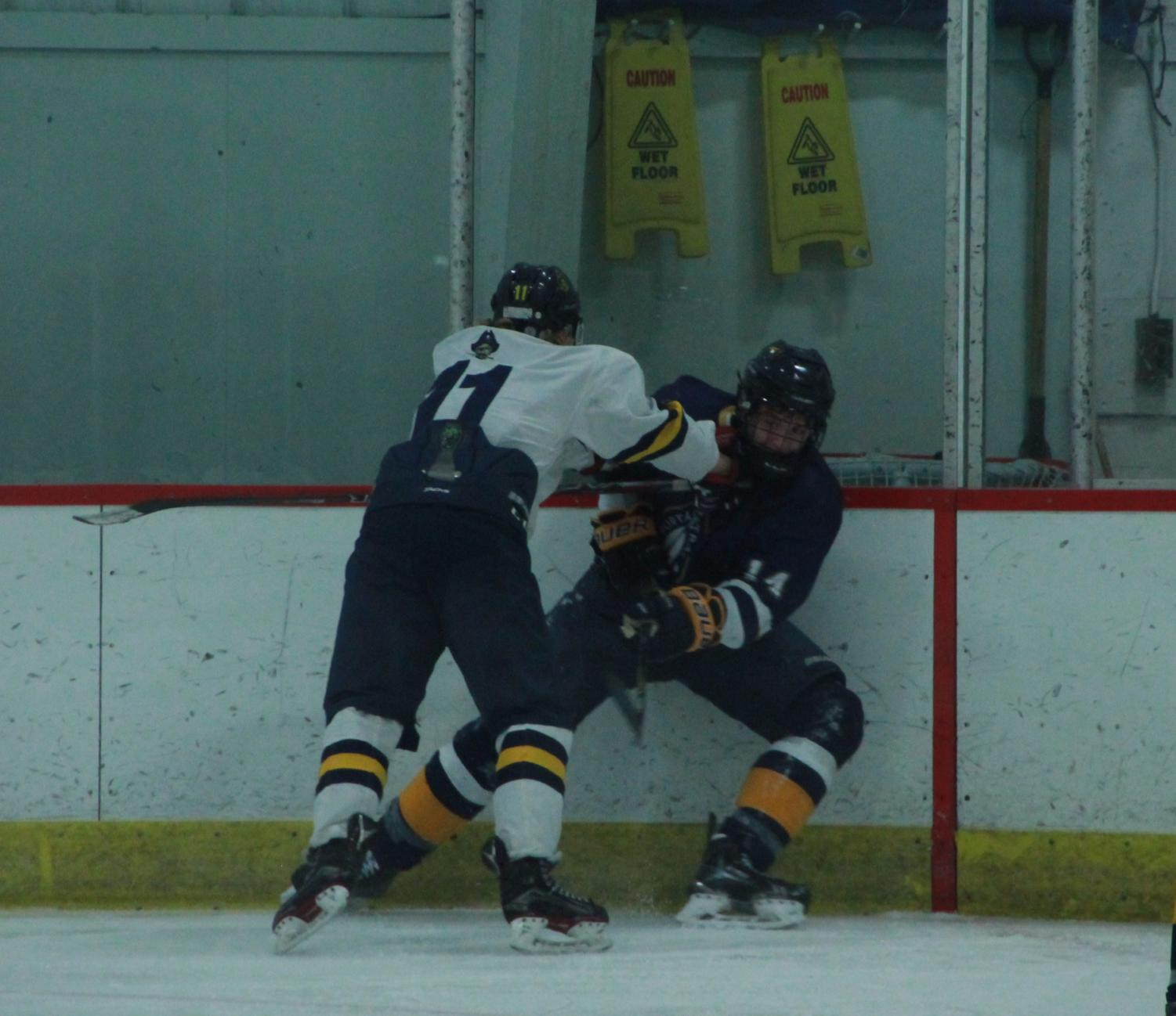 Sophomore Cooper Fox Checks One Of The Portage Central Defenders Into The  Boards, As Fox