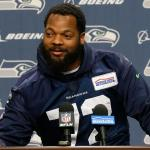 Michael Bennett sits during anthem, plans to protest all season