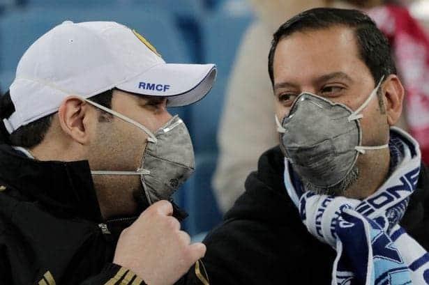 Fans in masks/ via business-live.co.uk