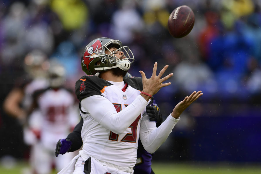Dec 16, 2018; Baltimore, MD, USA; Tampa Bay Buccaneers wide receiver Mike Evans (13) catches a pass in front Baltimore Ravens cornerback Jimmy Smith (22) during the second quarter at M&T Bank Stadium. Mandatory Credit: Tommy Gilligan-USA TODAY Sports