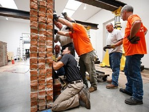 """A slideshow of the """"Brick Wall"""" exhibit we transported and installed at the Gagosian Gallery. Dan Colen's """"Brick Wall"""" was rigged into position using Jacking Gantries."""