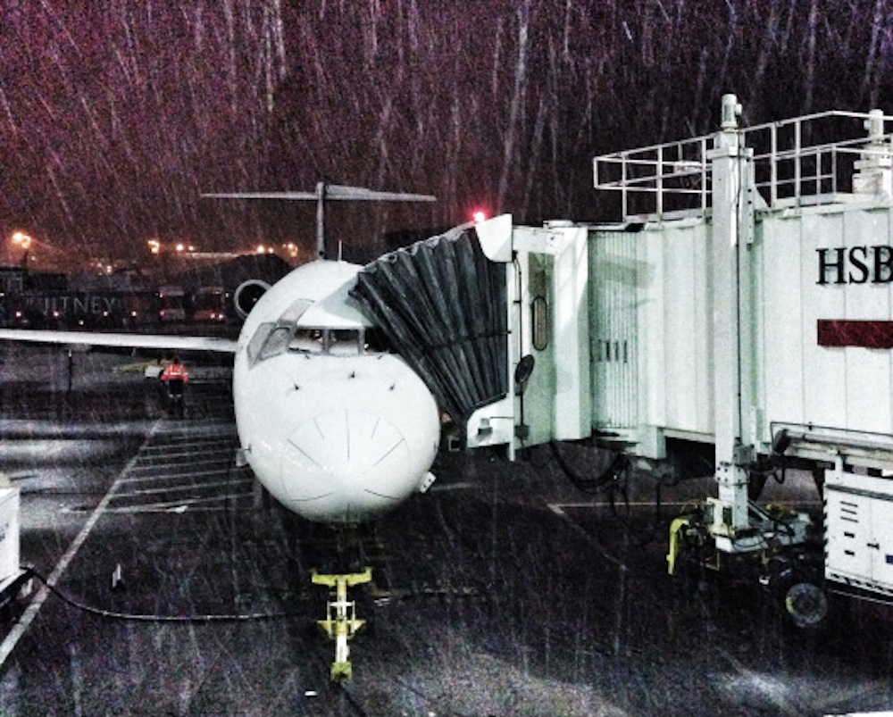 bangkok-flight-delay-jfk-plane-snow-buddha-drinks-fanta