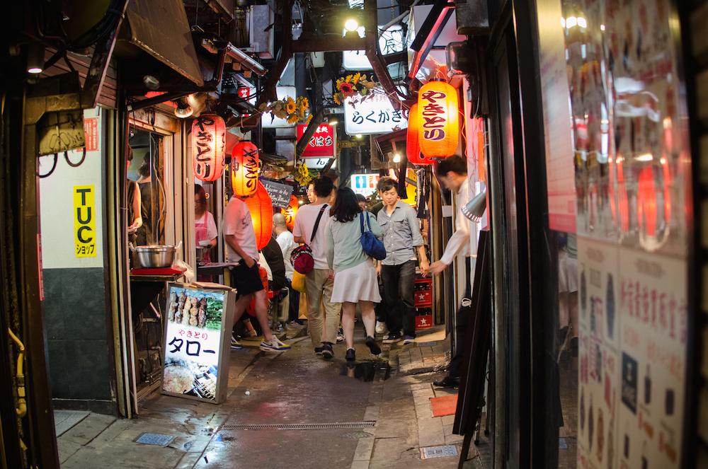 Omoide-Yokocho-Shinjuku-night-out-drinking-bars-yakatori-tokyo-japan-lanterns-izakayas-travel-buddha-drinks-fanta