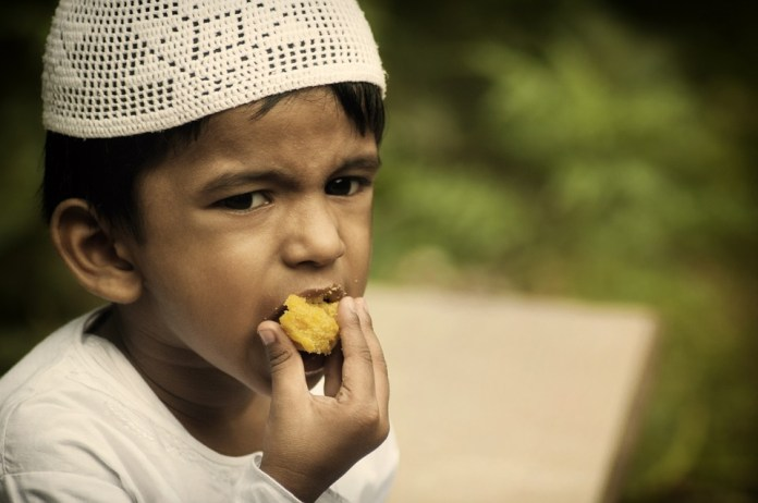boy eating during ramadan