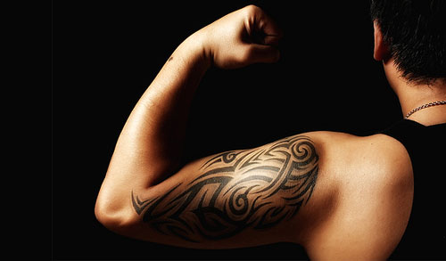 https://i0.wp.com/budgetsaresexy.com/images/tribal-tattoo-muscles.jpg
